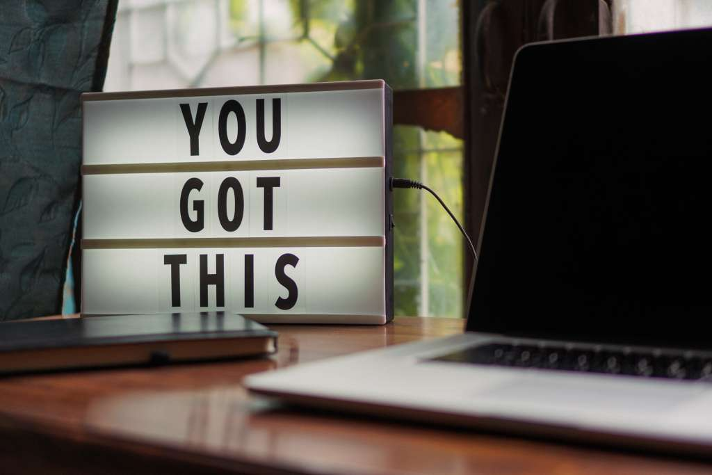 "Computer and sign that says ""You Got This"""
