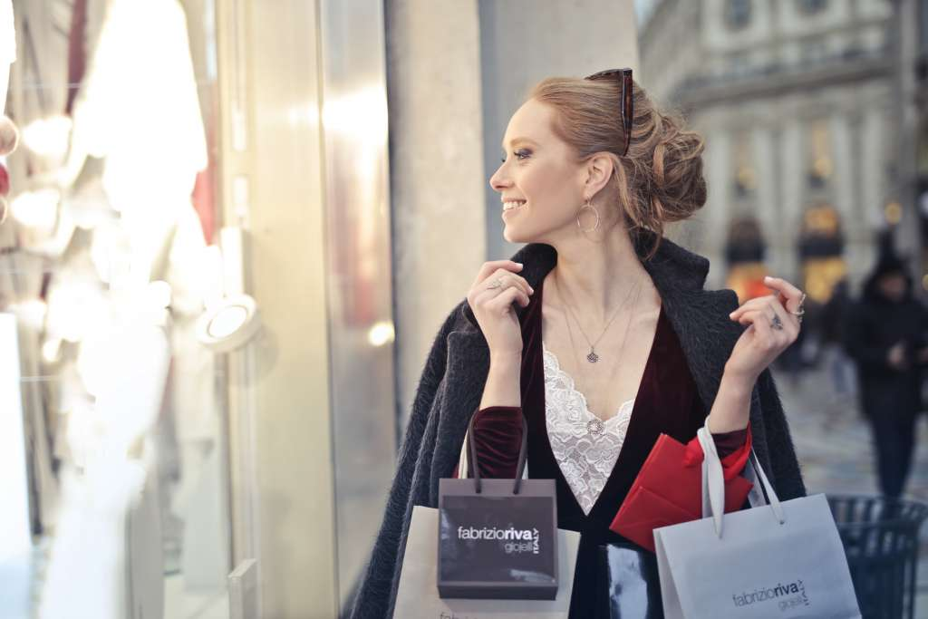 Elegant woman holding many shopping bags