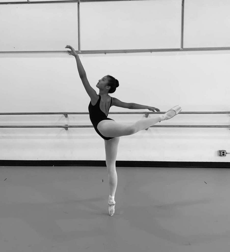 Shows an accomplished teen ballet dancer